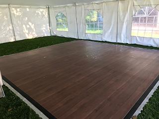https://www.acandsonspartytentrentals.com/wp-content/uploads/laminate-wood-grain-dance-floor.jpg